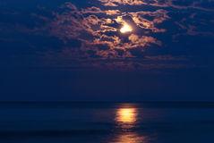 full-moon-night-sky-over-moonlit-water-42504986